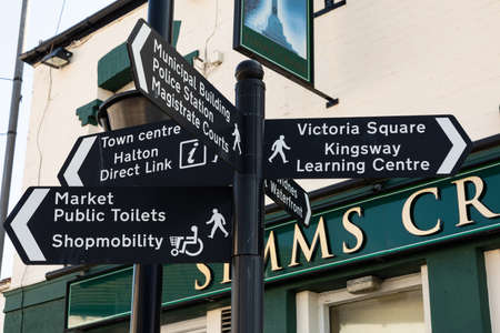 Signs in the town centre showing directions to many  local areas Widnes
