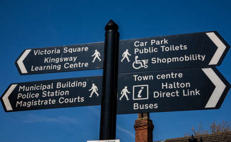 Pedestrian signs indicating multiple town centre locations Widnes Stock Photo