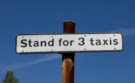 Sign indicating a taxi stand for three taxis in the town centre of Widnes Stock Photo