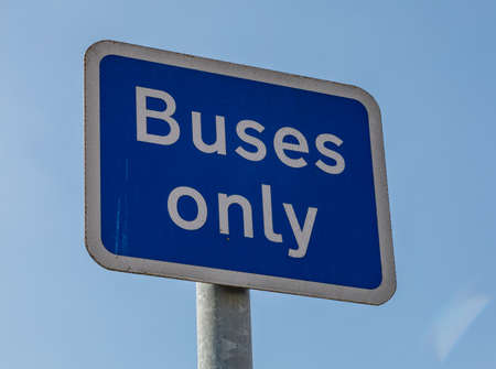 Blue and white road sign indicating buses only Widnes