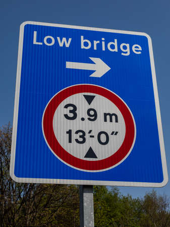 Sign indicating low bridge direction and height Wirral