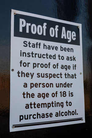 Sign outside a nightclub indicating staff will ask for proof of age Widnes England Stock Photo