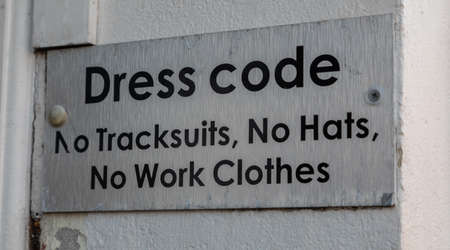 Sign outside a nightclub indicating dress code Widnes England