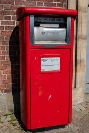 Red Royal Mail Collection box for franked mail Widnes April 2019 Editorial