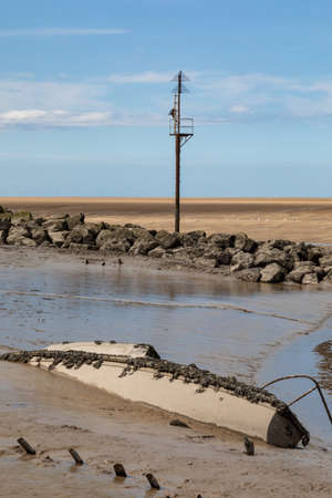 Wreck of a small boat in the mud at Leasowe Wirral June 2019