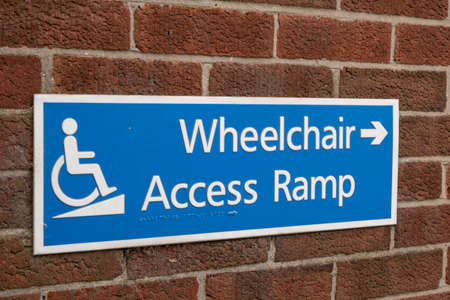 sign with braille indicating wheelchair access ramp in Birkenhead Wirral Jaunary 2020