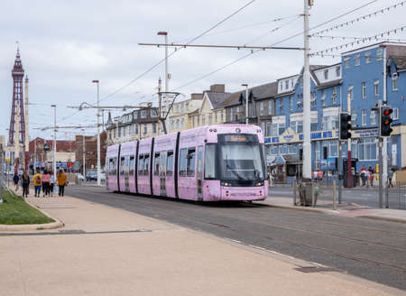 Tram with tower in background in Blackpool August 2020 Editorial