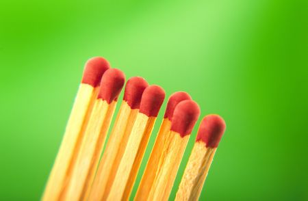 fusible: seven located it  horizontal red matches on  green background Stock Photo