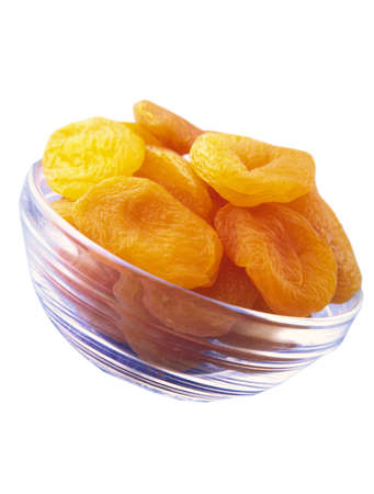 Large orange dried apricots in a glass transparent plate on a white background Stock Photo - 828082