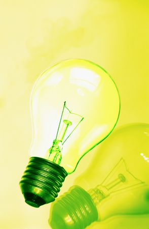 One electric lamp on  smooth surface on it is yellow  green background photo