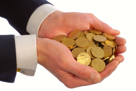 businessman holds in hands many gold coins on  white background,  close up