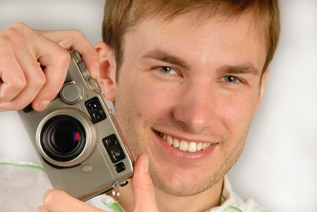 specifies: young man with  camera in  hand specifies  finger, close up