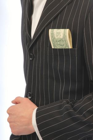 At  businessman in  black jacket from  pocket dollars stick out photo