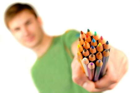 finders: guy suggests and holds  set of color pencils in  hand on  white background; close up