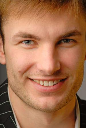Portrait  smiling young businessman, close up Stock Photo