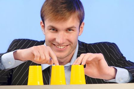 businessman plays bad financial business - constructed on  deceit Stock Photo - 910362