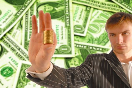 businessman holds monetary coins in a hand photo