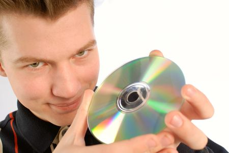 compact disk: young guy holds in hands  compact disk (CD and DVD) on  white background