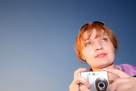 woman with  digital camera on  background of  night sky photo
