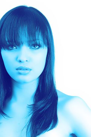 young woman looks in an objective,  portrait in dark-blue tonalities Stock Photo - 948260