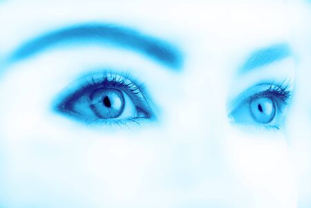female eyes look in top on  white background,  close up Stock Photo