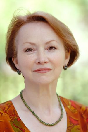 portrait of  woman in  age of on  light green background