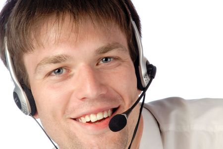 young smiling businessman works in headphones with  microphone and looks in an objective, close-up Stock Photo - 1117695