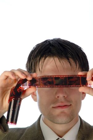 considers: young businessman considers  film,  close up