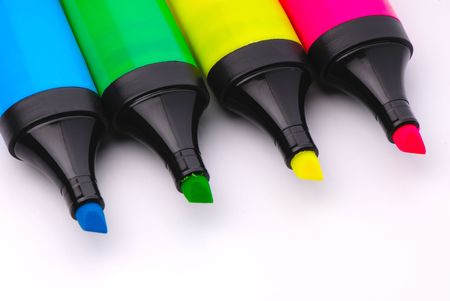 four colorful markers isolated on white background photo