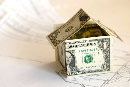 design drawings for construction of  house and monetary denominations of dollar simulating  house  photo