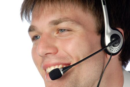 young smiling businessman works in headphones with  microphone