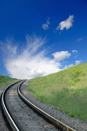 railway and  dark blue sky with white clouds, spring Stock Photo