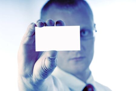 smartness: businessman holds  card in  hand