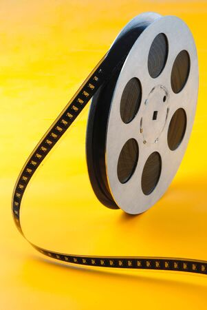 reel of  film of 16 mm on  yellow background