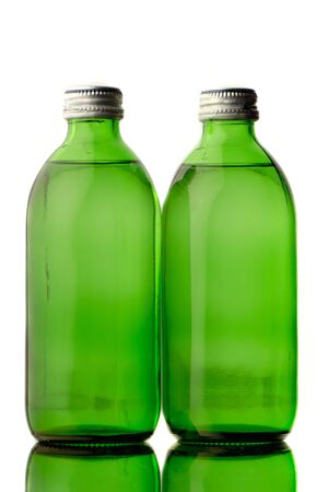 useful: two bottles  green color with mineral water on  white background Stock Photo