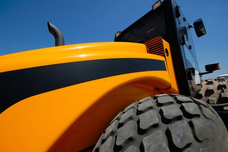 steam-roller on  background of  dark blue sky, close-up Stock Photo - 1349518