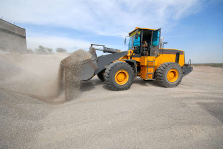 delivers: industrial loader delivers building rubble Stock Photo