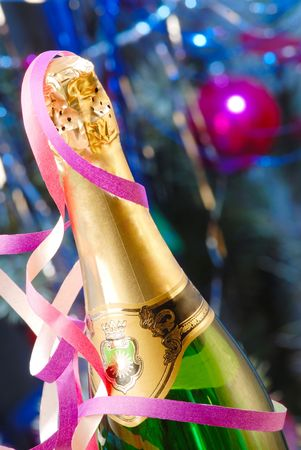 bottle of champagne on  background of  New Year tree photo
