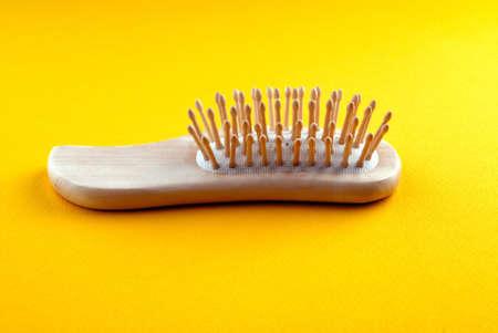 trashy: hairbrush on  yellow background Stock Photo