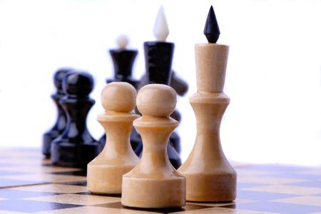 chessmen: chess-men black and white on  chess board