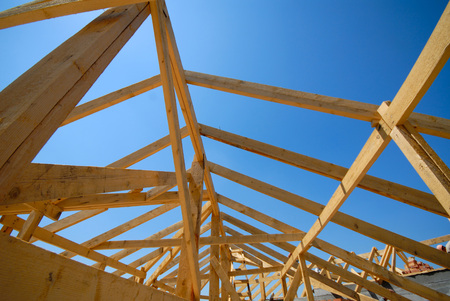 wooden building designs on  background of  blue sky photo