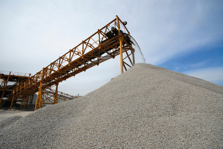 industrial conveyor on delivery of building rubble to  warehouse photo