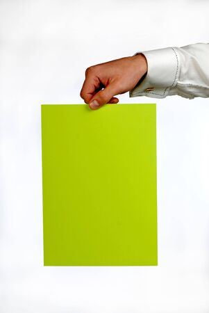 assertion: hand of  businessman with  green sheet of  paper on  white background