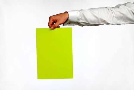 preference: hand of  businessman with  green sheet of  paper on  white background
