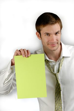 assertion: young businessman holds in hand  green sheet of  paper on  white background