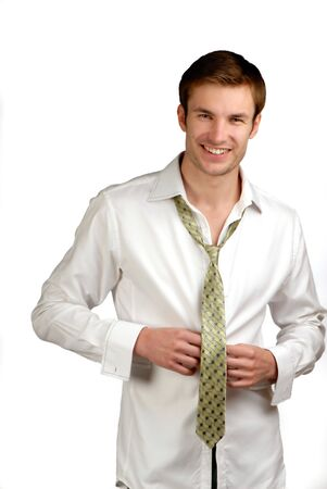 young businessman dressed in  shirt and  tie on  white background Stock Photo - 2025510