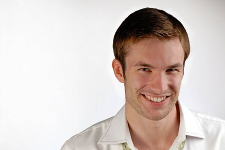 portrait of  cheerful young businessman in  shirt on white background Stock Photo - 2025554