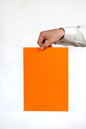 assertion: hand of  businessman with  orange sheet of  paper on  white background