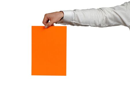 allegation: hand of  businessman with  orange sheet of  paper on  white background