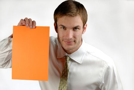 young businessman holds in hand  orange sheet of  paper on  white background